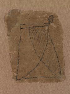 Fragment de bandelette de momie, décorée d'un pagne Lin, encre